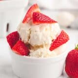 ice cream and strawberries in white bowl