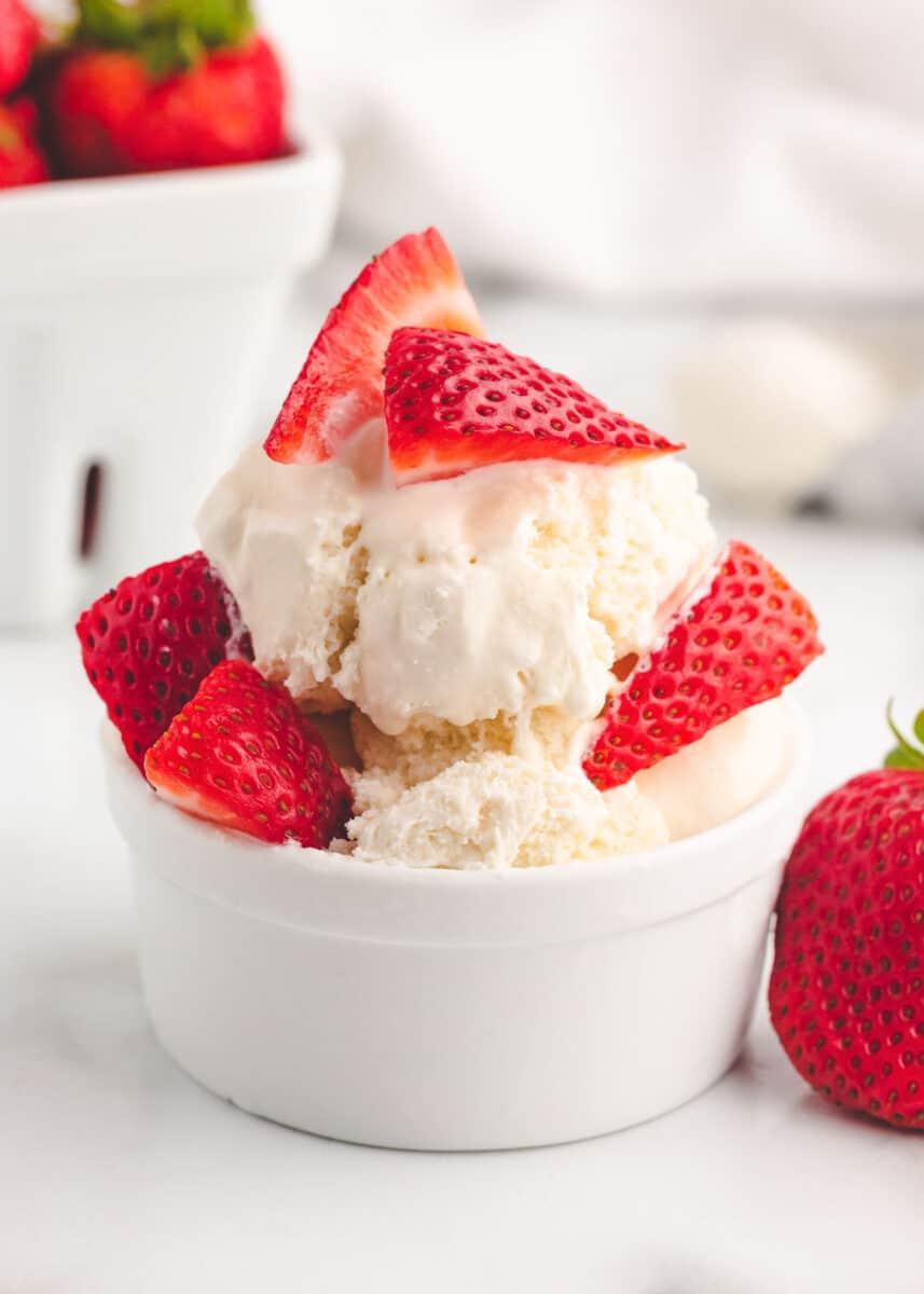 vanilla ice cream and strawberries in white bowl