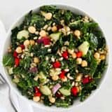 kale quinoa salad in white bowl