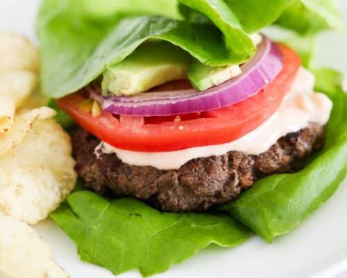 lettuce wrap burger on white plate