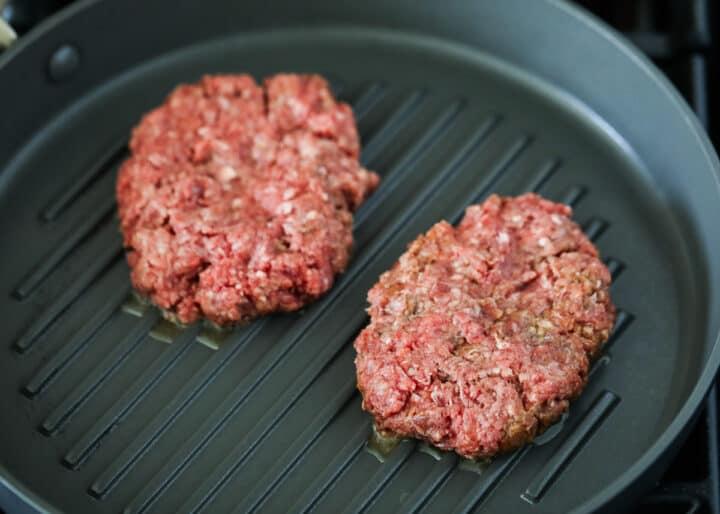 burger patties on pan