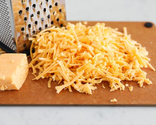 grated cheese on cutting board