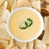 nacho cheese dip in bowl and chips