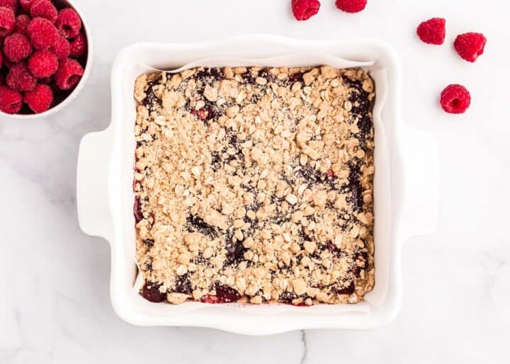 raspberry crumb bars in white pan