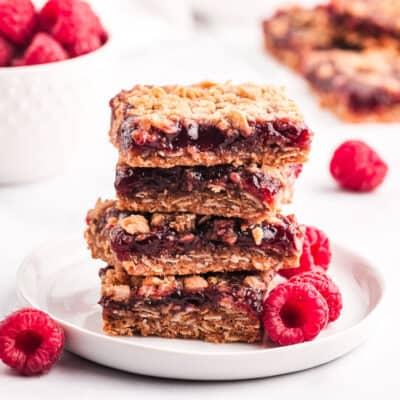 raspberry crumb bars on white plate