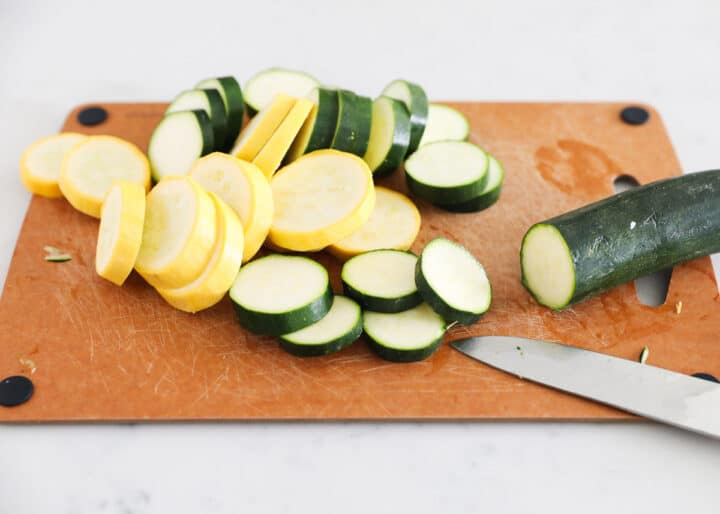 zucchini and squash on cutting board