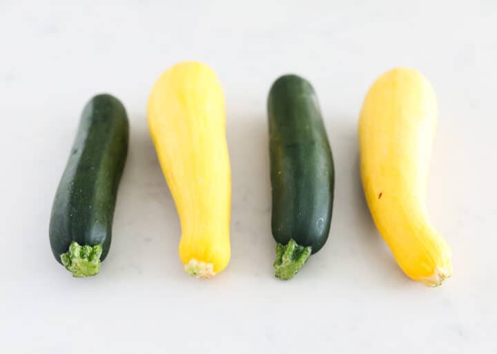 zucchini and squash on table