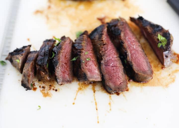teriyaki steak slices on cutting board