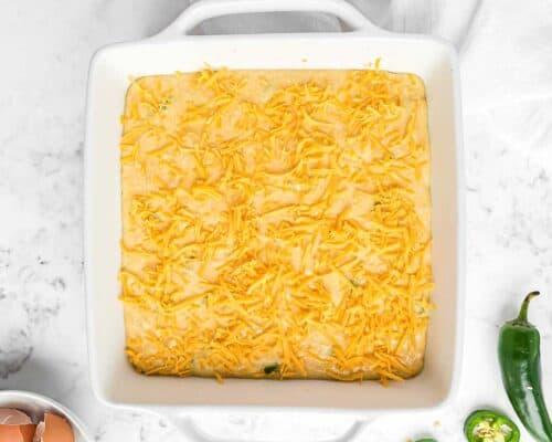 mexican cornbread batter in white pan