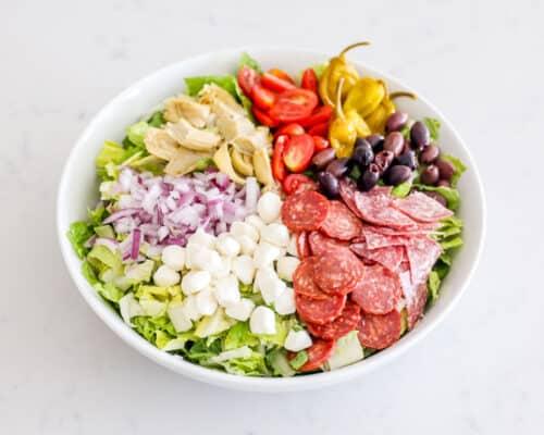 antipasto salad ingredients in bowl