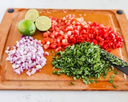 chopping fresh produce on cutting board