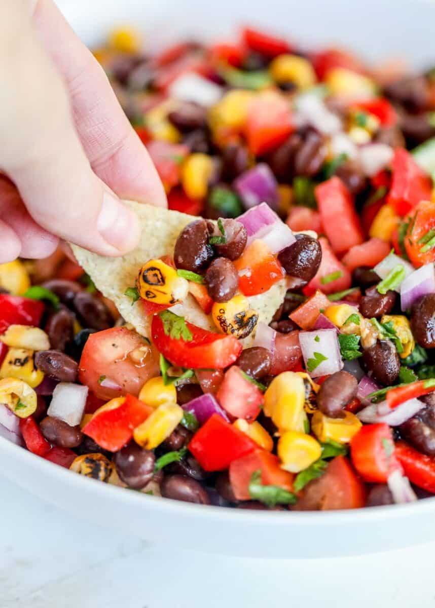 dipping chip in black bean salsa