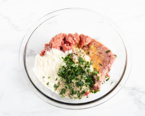 meatball ingredients in glass bowl