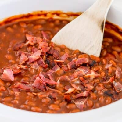 wooden spoon in baked beans