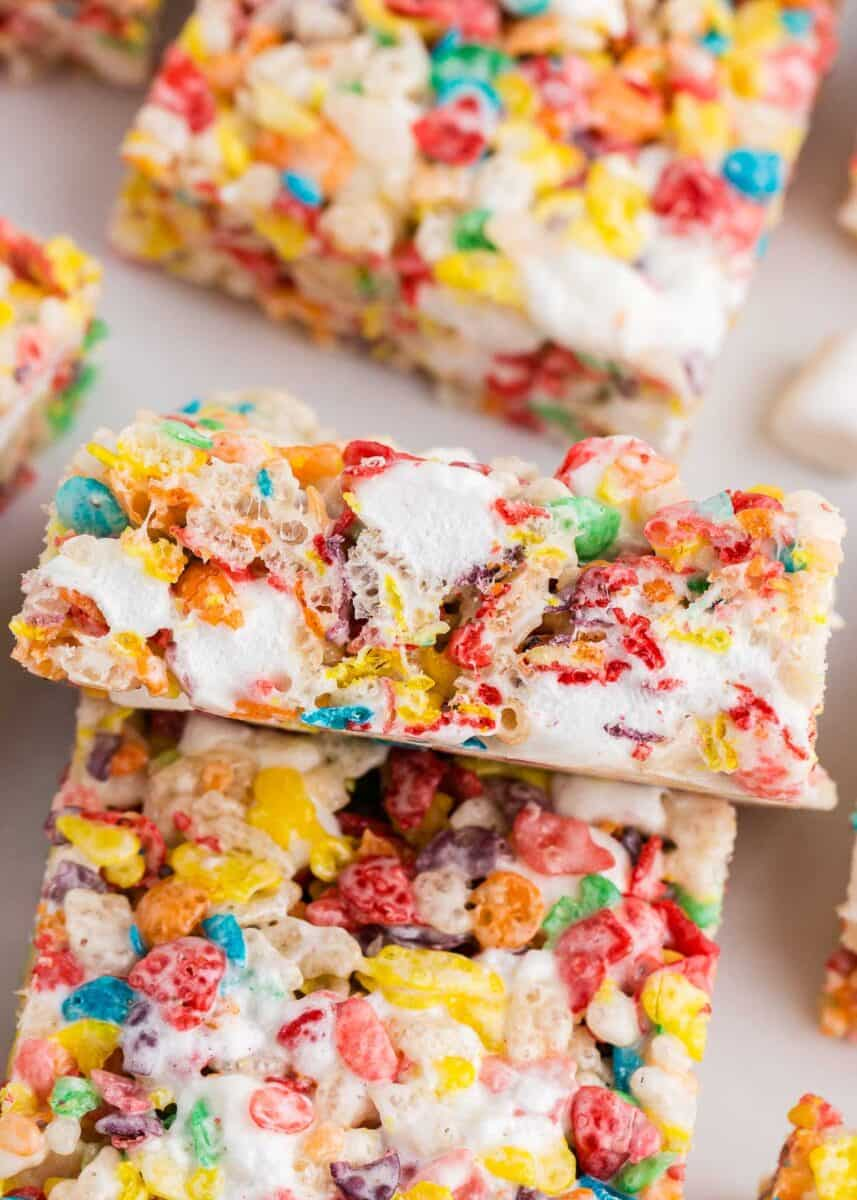 close up of sliced fruity pebbles treats on counter