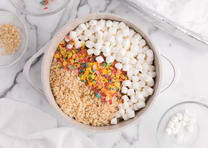 rice krispies, fruity pebbles and marshmallows in pot