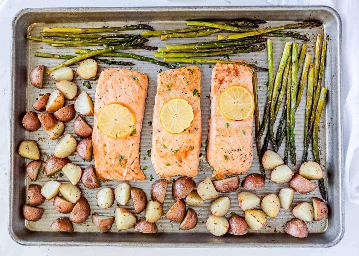 salmon, potatoes and asparagus on pan