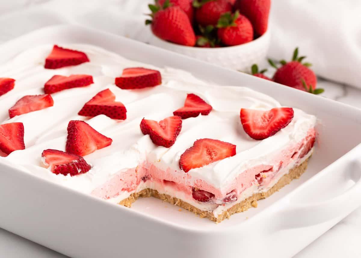 strawberry lasagna in white casserole dish