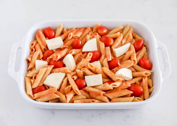 noodles, tomatoes and cheese in baking dish