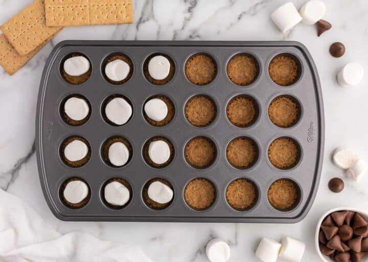 marshmallow on top of graham in muffin pan
