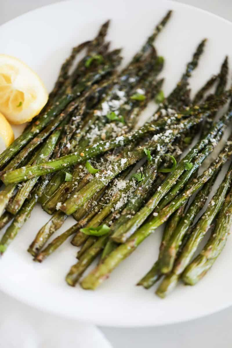 grilled asparagus on white plate