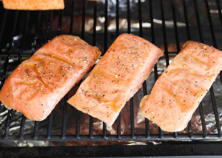 salmon cooking on grill