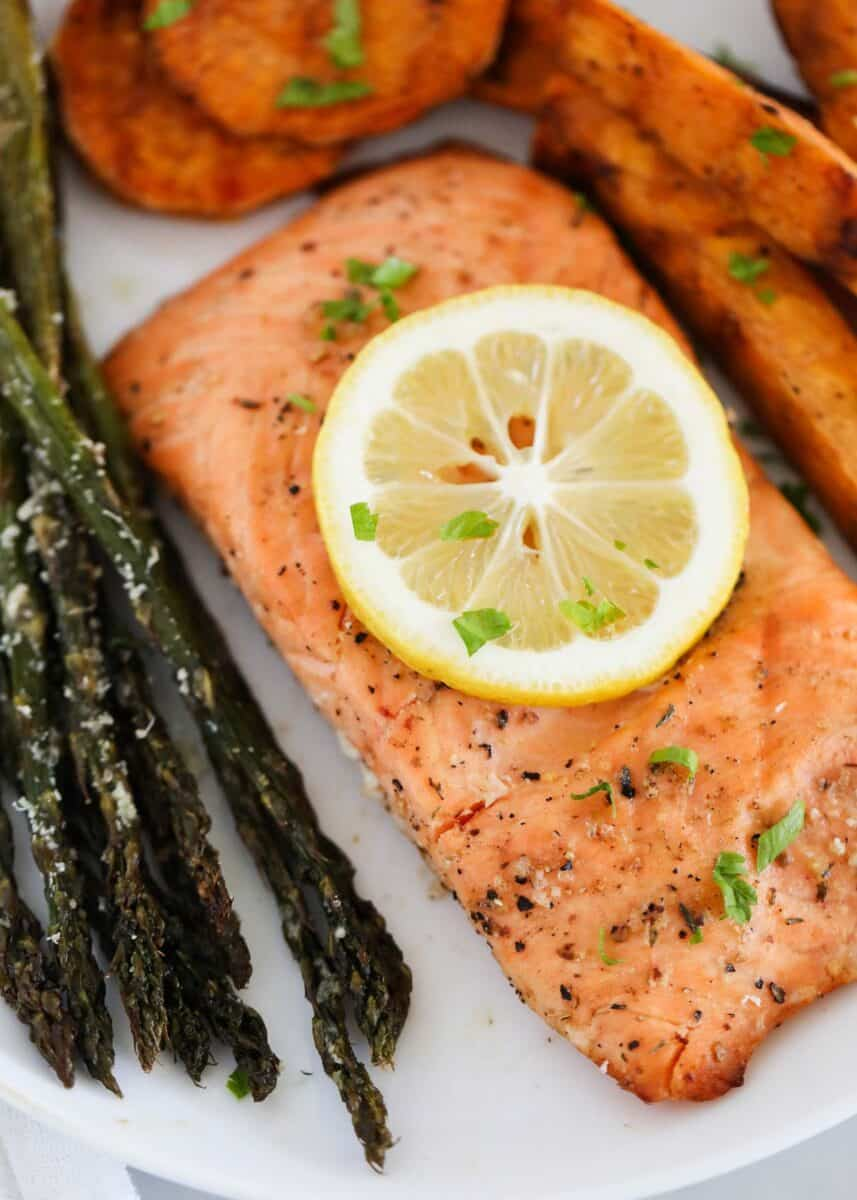salmon, asparagus, and sweet potatoes on white plate