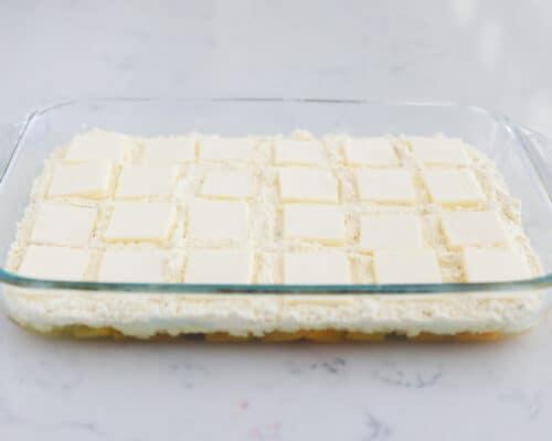 peach dump cake ingredients in clear pan
