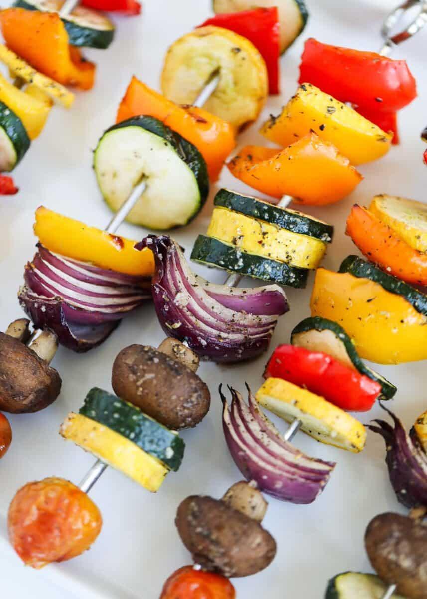 vegetable skewers on white platter