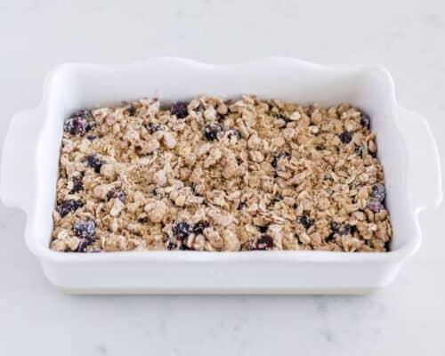 blueberry crisp ingredients in white baking dish