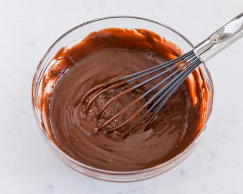 whisking chocolate pudding in bowl