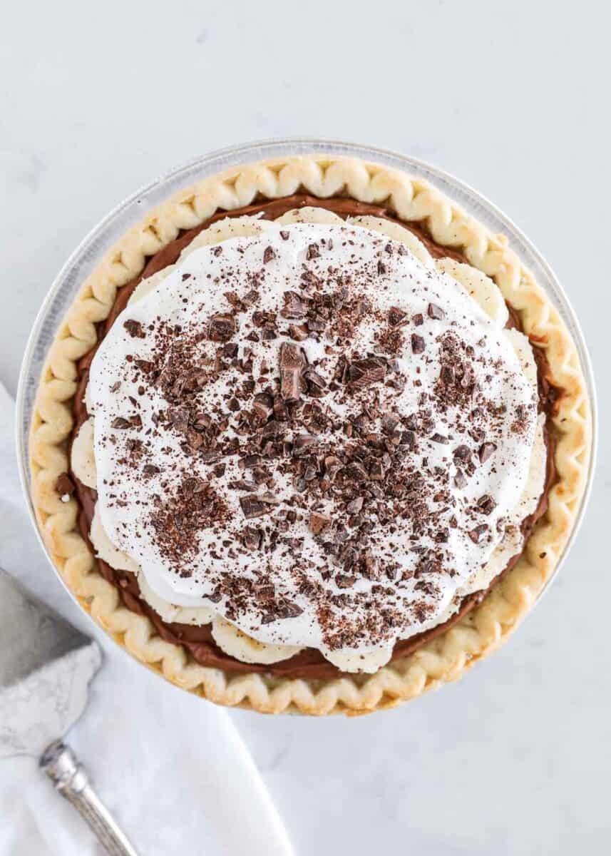 chocolate banana cream pie sitting on counter