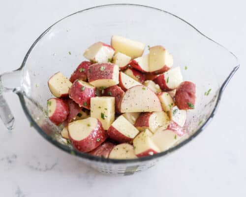 rosemary potatoes in glass bowl