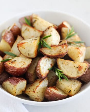roasted potatoes in white bowl