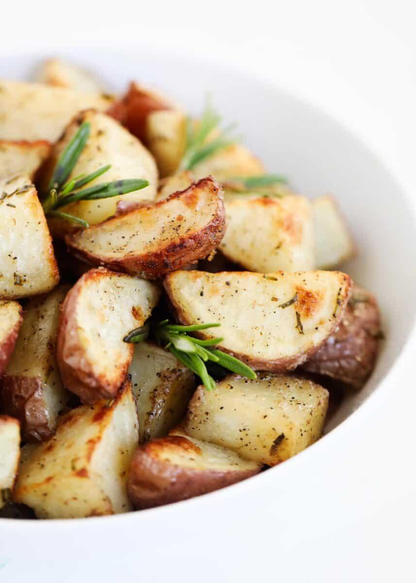 rosemary potatoes in white bowl