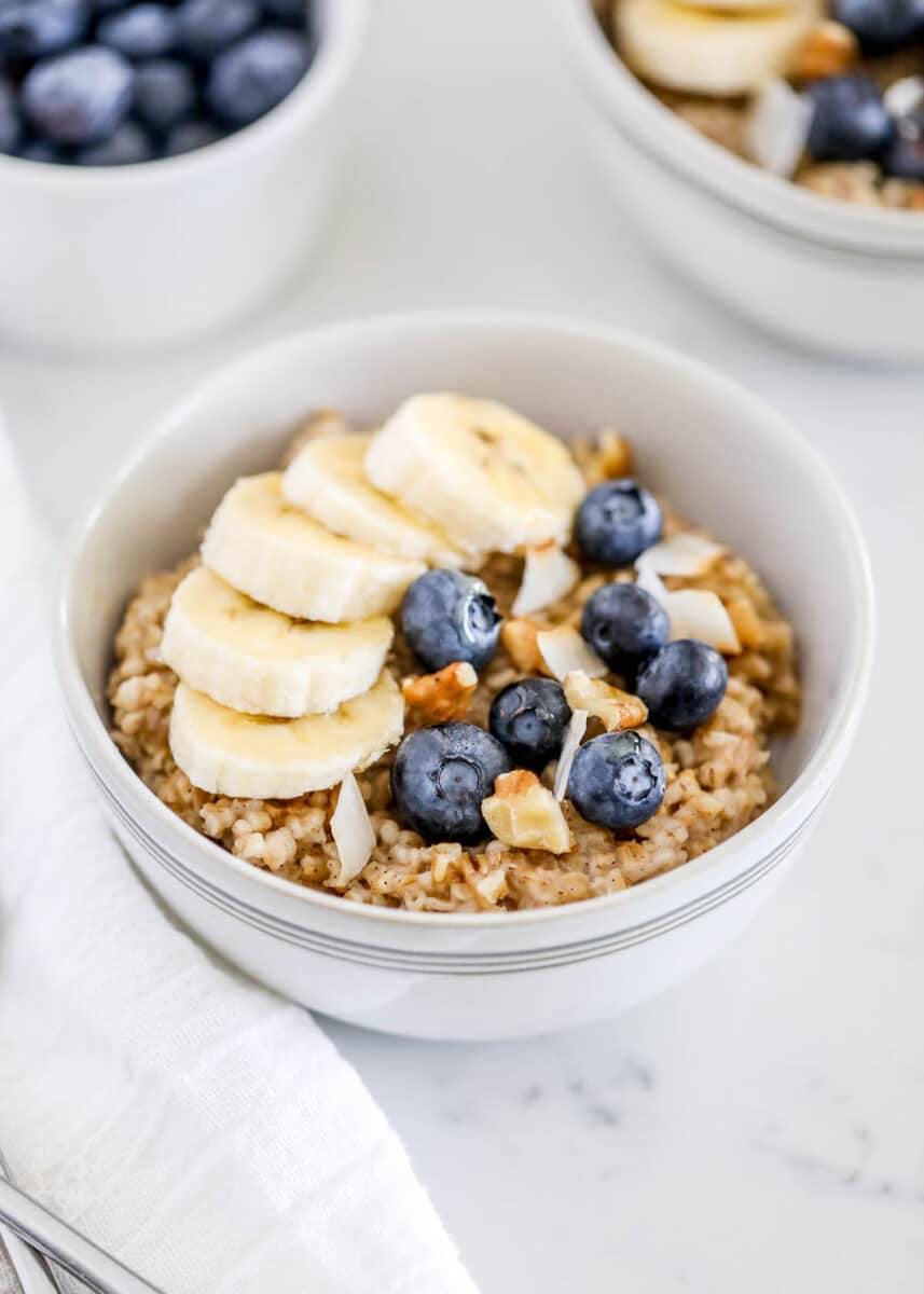 bowl of steel cut oats with blueberries and bananas