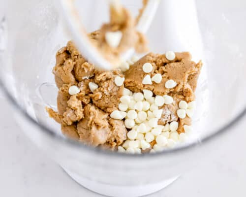 cookie dough and white chocolate chips in bowl
