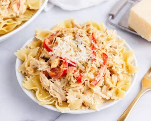 creamy chicken pasta on white plate