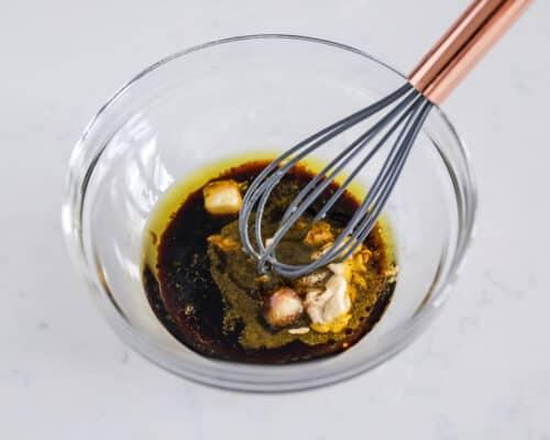 whisking marinade in bowl