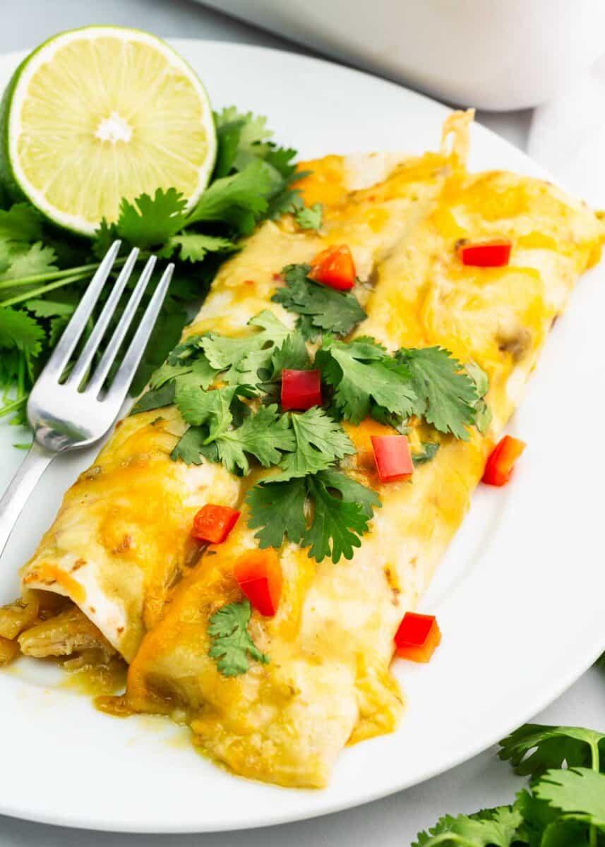 green chile chicken enchiladas on white plate