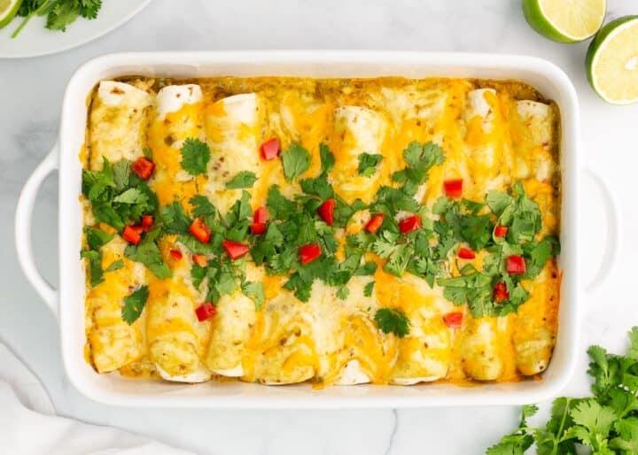 green chile chicken enchiladas in pan