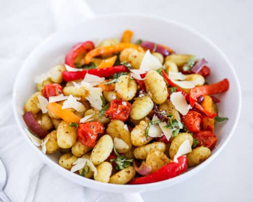 white bowl with gnocchi and vegetables