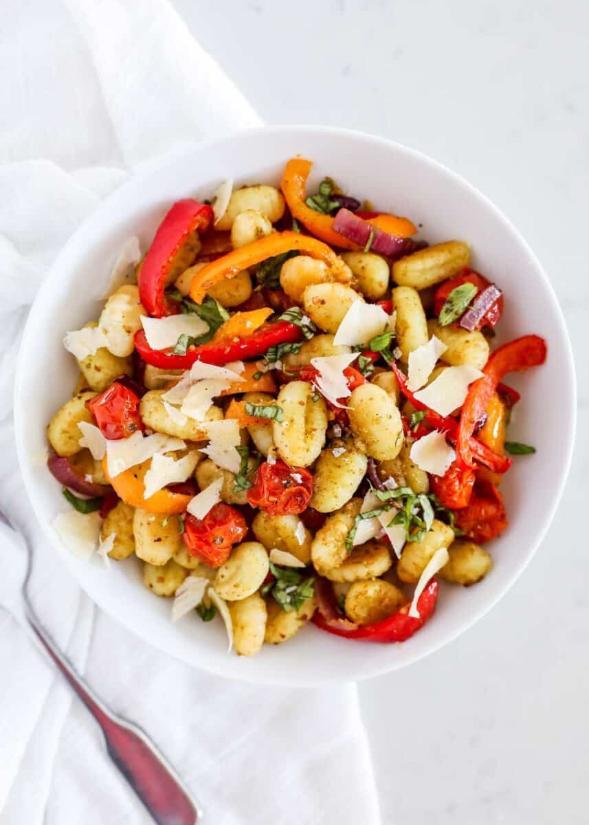 gnocchi and vegetables in white bowl