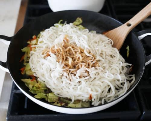 cooking rice noodles in skillet