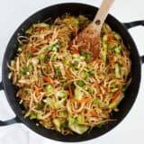 chow mein noodles in black skillet