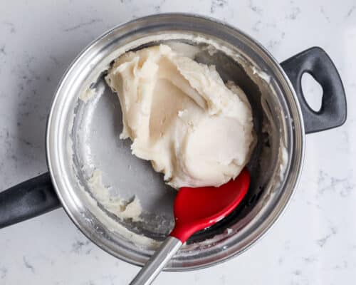 mixing together play dough in pan