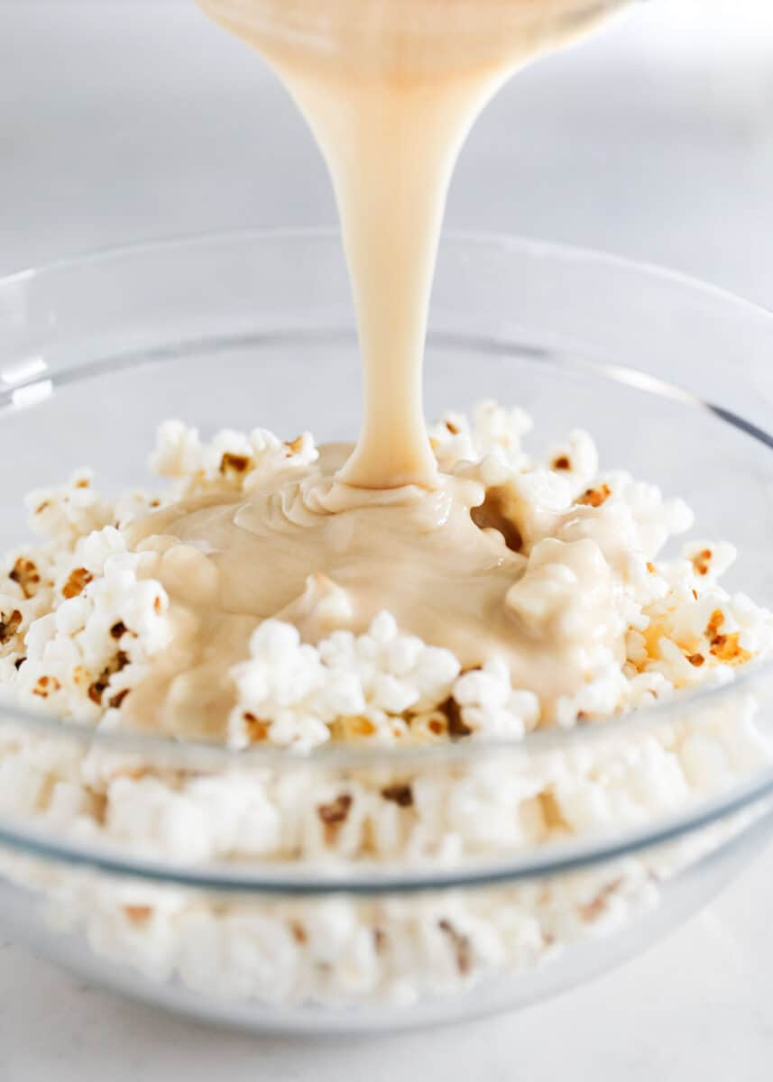 pouring caramel into popcorn