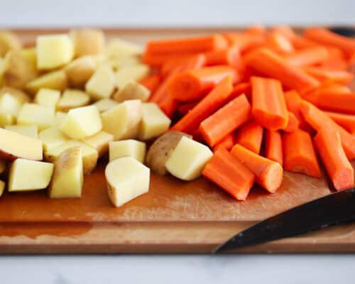 potatoes and carrots on cutting board