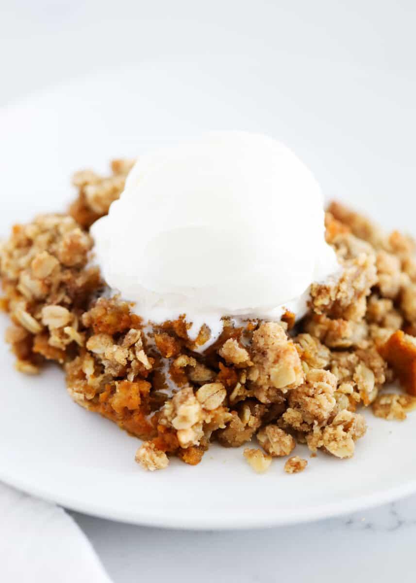 pumpkin crisp with ice cream on plate
