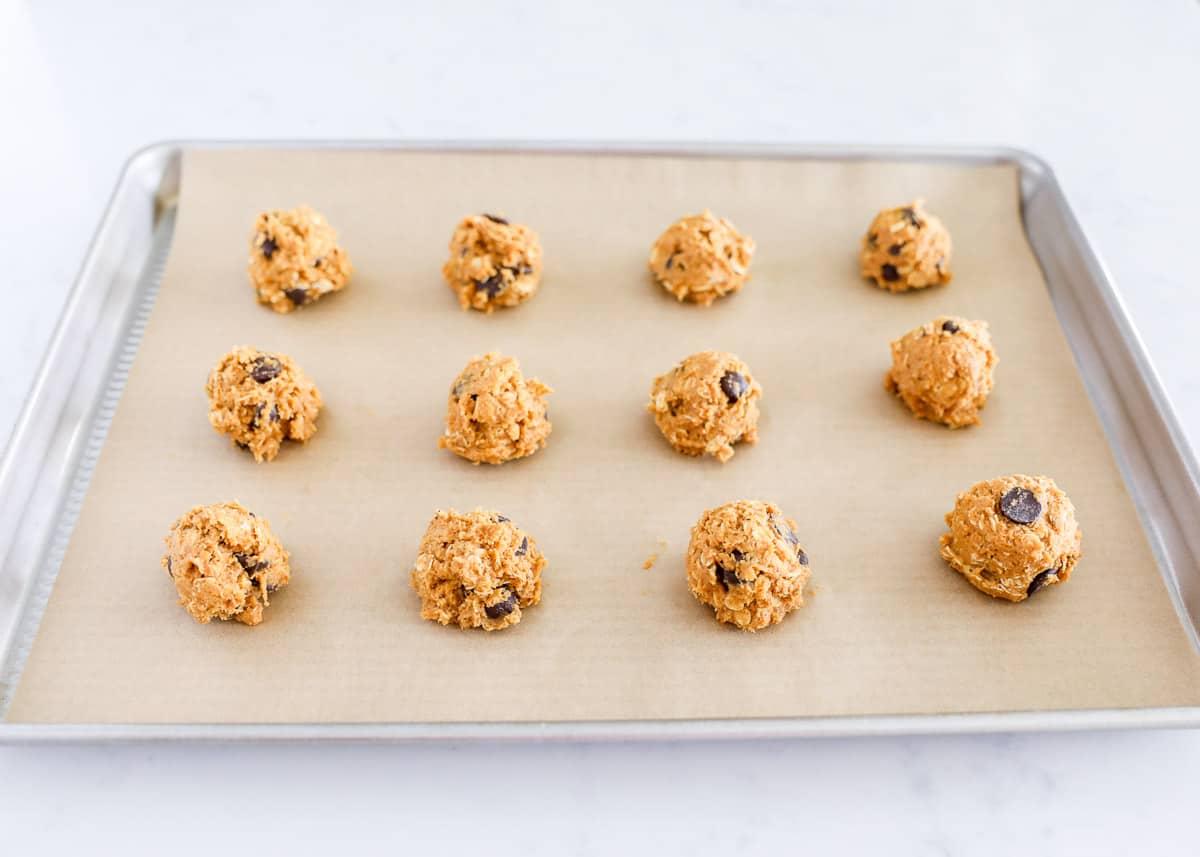 pumpkin cookie dough balls on pan